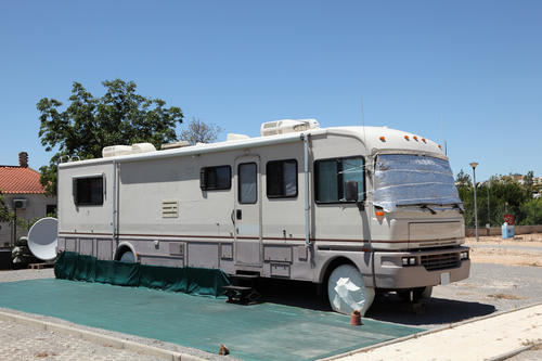 Large RV on a camping site, reversible mat